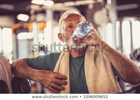 komoly · férfi · üveg · víz · tornaterem · modell - stock fotó © photography33