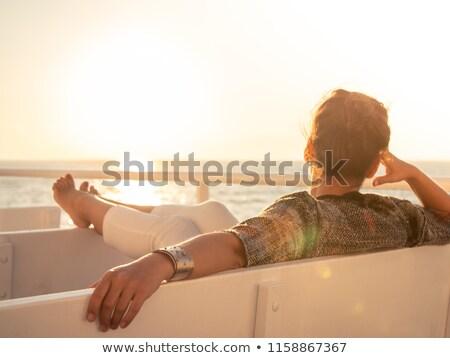 Woman enjoying sea and sun Stock photo © nikitabuida