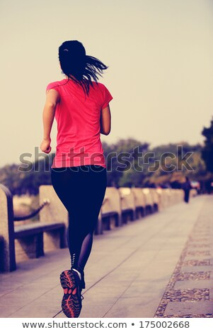 beautiful red woman exercising at the beach stock photo © nikitabuida
