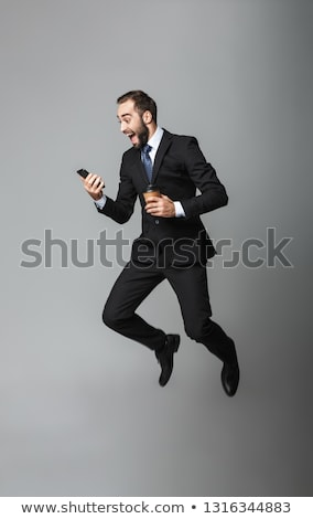 jonge · zakenman · telefoon · business · kantoor · gelukkig - stockfoto © photography33