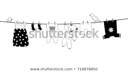 baby on laundry line stock photo © nailiaschwarz
