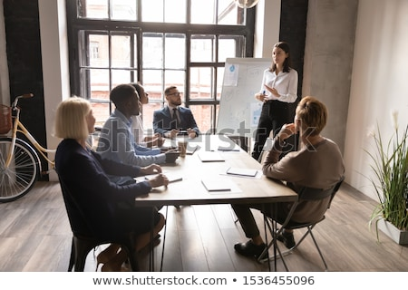 Conference room with tables with people Stock photo © backyardproductions