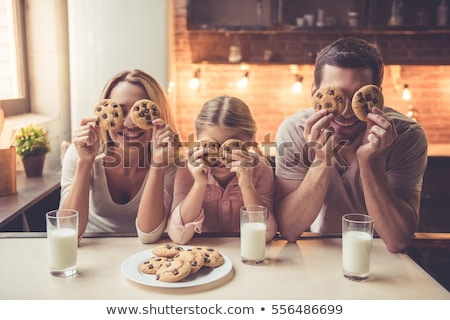 three young women having breakfast at home stock photo © photography33