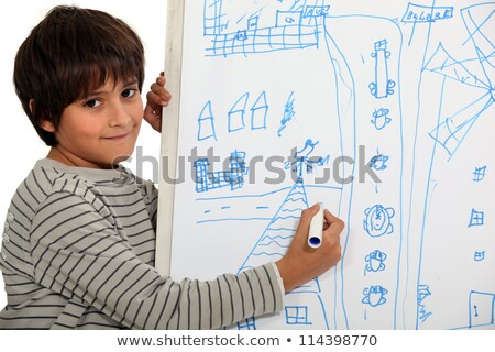 a little boy drawing on a whiteboard Stock photo © photography33