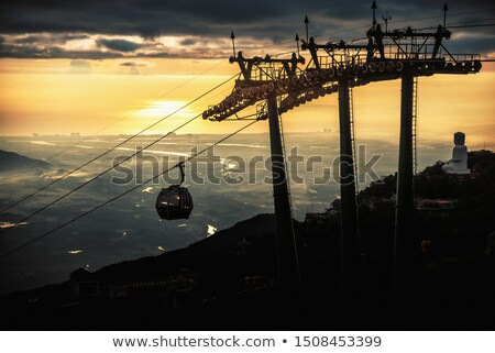 Industrial landscape with silhouettes of cranes on the sunset ba Stock photo © rufous