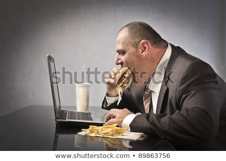 businessman eating junk food stock photo © photography33