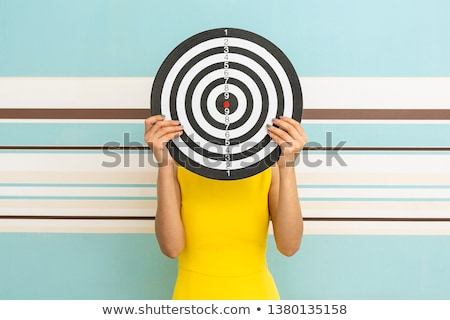 Determined woman holding a dart Stock photo © photography33