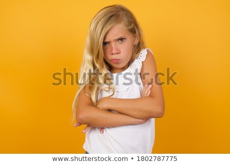 angry blond children girl portrait looking camera stock photo © lunamarina