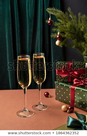 two glasses of champagne with a present in background Stock photo © Rob_Stark