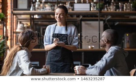 Pár pincérnő boldog üveg levél kávézó Stock fotó © photography33