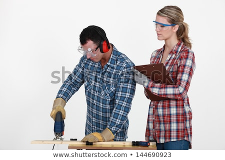 Man using band saw whilst woman supervises Stock photo © photography33