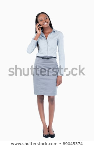 confident young businesswoman talking on phone against white background stock photo © wavebreak_media