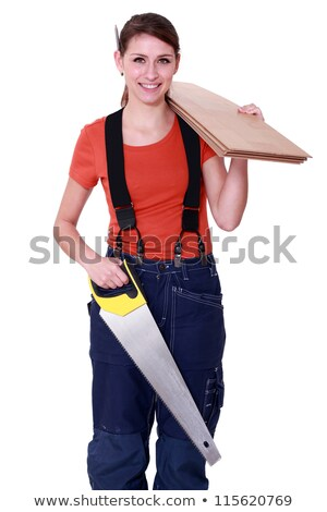 Stock photo: Woman carrying plywood and a saw