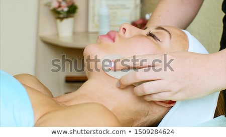 facial massage relaxing theraphy on woman face stock photo © lunamarina