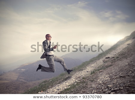 Businessman climbing a hill Stock photo © Rugdal