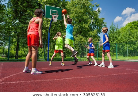 Caucasian boy playing basket ball stock photo © get4net