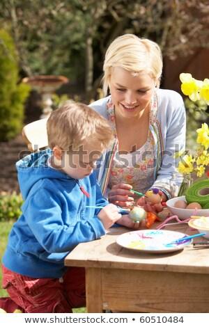 Madre figlio easter eggs tavola esterna donna Foto d'archivio © monkey_business