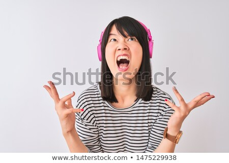 young asian woman shouting in frustration stock photo © bmonteny