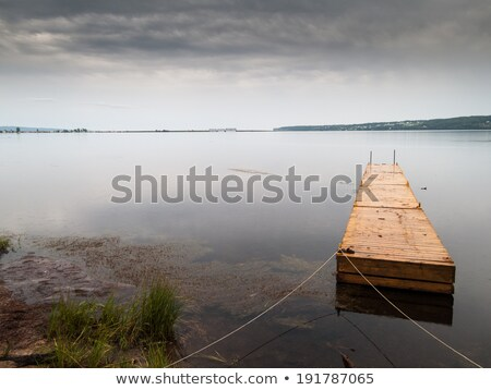 Wooden pier at a riverside, Quebec, Canada Stock photo © bmonteny