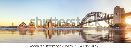 Sydney ponte porto noite nuvens edifício Foto stock © Vividrange