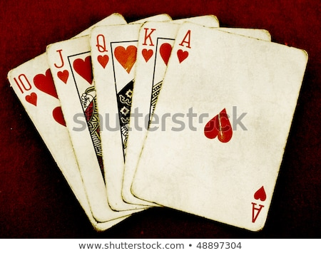 Stock photo: Royal flush old vintage poker cards close up.