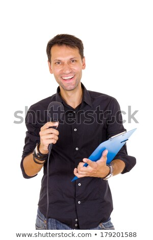 handsome male journalist reporting news on microphone with notes Stock photo © feelphotoart