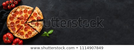 Tasty Italian pizza with pepperoni and mushrooms  Stock photo © Elisanth