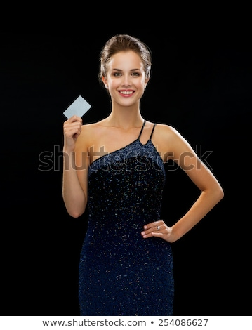 Stock photo: woman in evening dress with plastic card