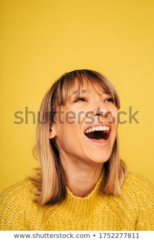 Káprázatos nevet játékos fiatal nő mosoly néz Stock fotó © stryjek