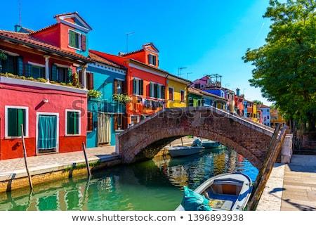 île coloré maisons nuageux ciel eau Photo stock © twindesigner