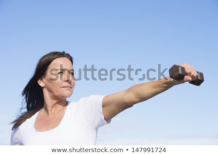Confident energetic sporty mature woman Stock photo © roboriginal