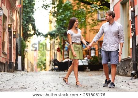 пару ходьбе улице старый город счастливым Сток-фото © deandrobot