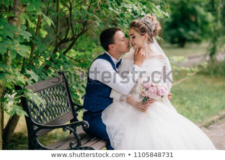 fiance and bride kiss on the bench stock photo © Paha_L