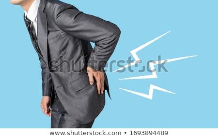 pijnlijk · Maakt · een · reservekopie · achteraanzicht · jonge · man · aanraken · hand - stockfoto © tashatuvango