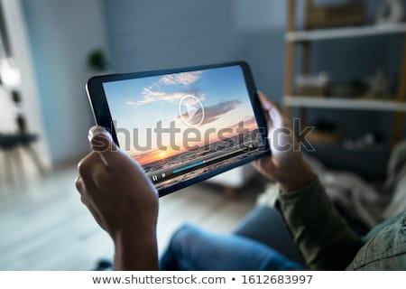 assistindo · comprimido · mulher · jovem · sessão · retro · cadeira - foto stock © filipw