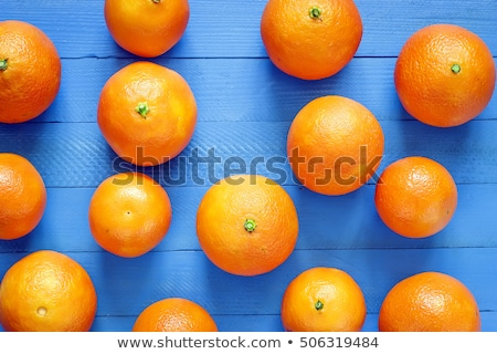 Colorful orange mandarins on a blue picnic table stock photo © ozgur