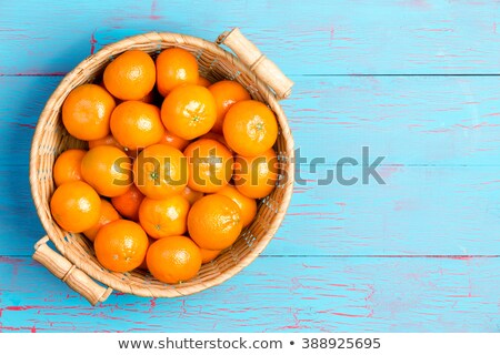 Top down view of clementines in basket Stock photo © ozgur
