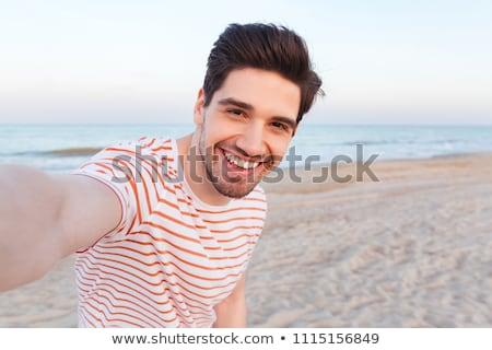 Fotó jóképű fickó divat haj férfiak Stock fotó © konradbak