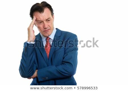 Businessman having an headache Stock photo © stokkete