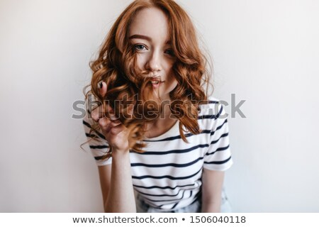 Romantic style photo of a young ginger hair lady stock photo © konradbak