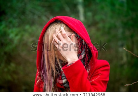 Scared Little Red Riding Hood Hiding in the Forest Stock photo © NicoletaIonescu