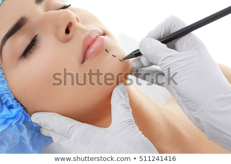 Plastic surgery touching the head of a beautiful female face Stock photo © konradbak