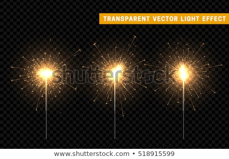 Burning christmas sparkler isolated on black background. Bengal  stock photo © kayros