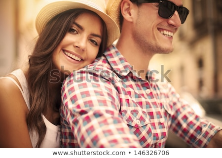 Lovely young woman in a hat riding a bicycle on city background  Stock photo © vlad_star