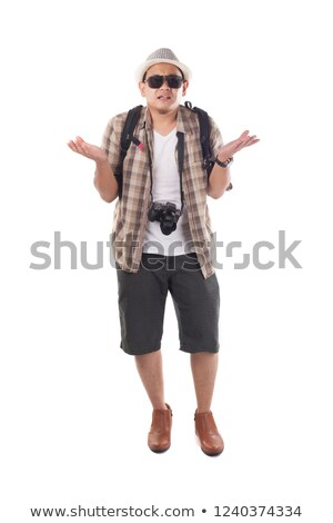 Asian confused traveler shrugging shoulders. Stock photo © RAStudio