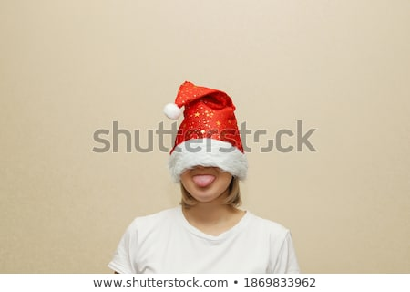 Stock photo: Woman in red hat shows her tongue