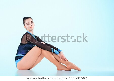The girl sitting after gymnastics dance on a blue background Stock photo © master1305