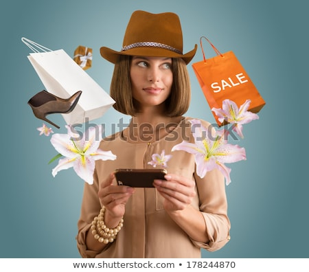 woman with shopping bags and shoes in her thoughts stock photo © lordalea