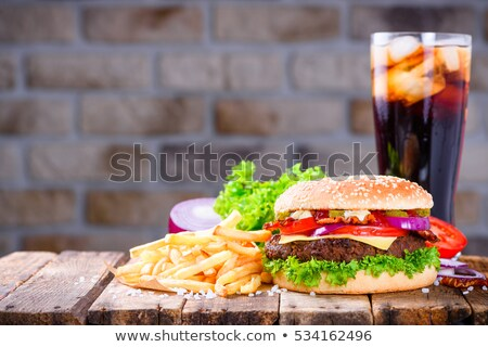 hamburger french fries and cold drink on table stock photo © wavebreak_media