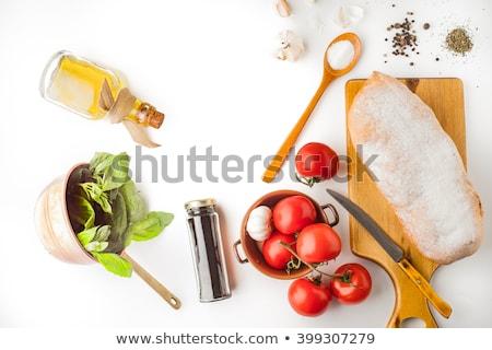 Salt in glass bottle. Seasoning on white background Stock photo © MaryValery